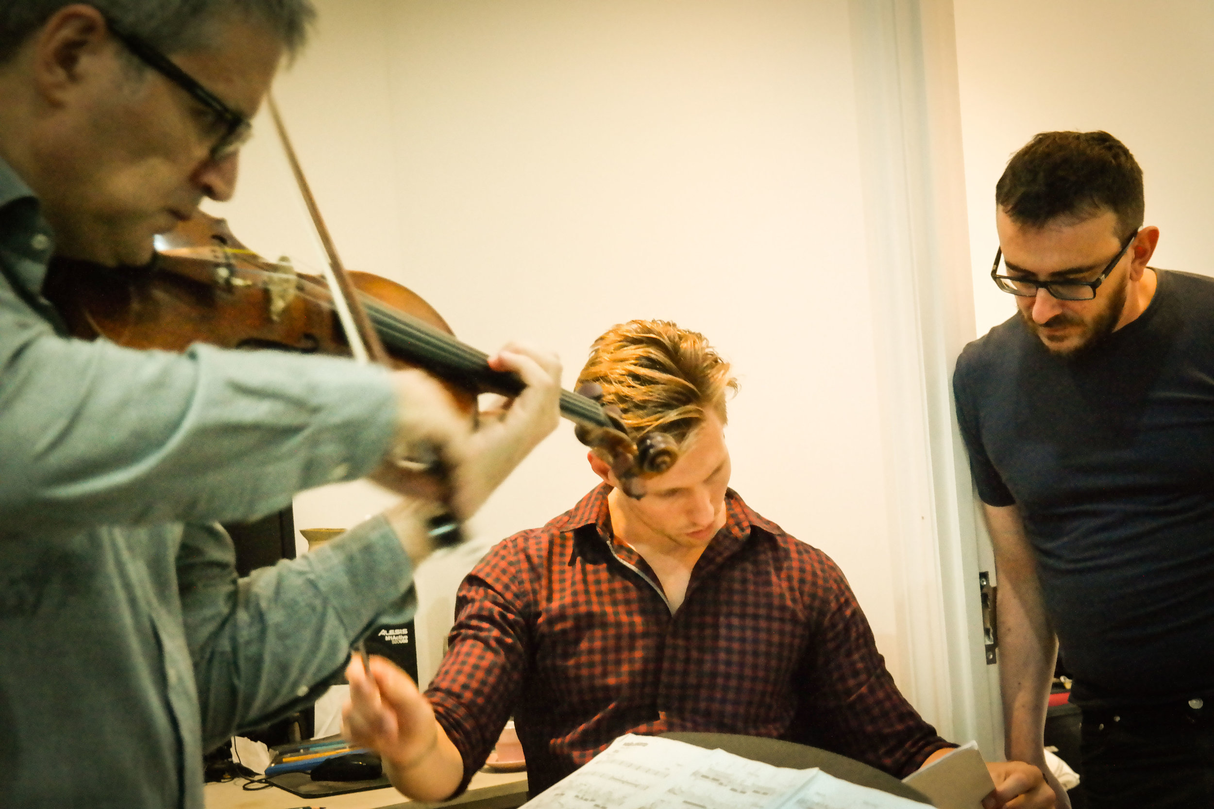 Francesco D'Orazio (violin), Lee Reynolds (conductor) and Vito Palumbo (composer) rehearsing for the session.
