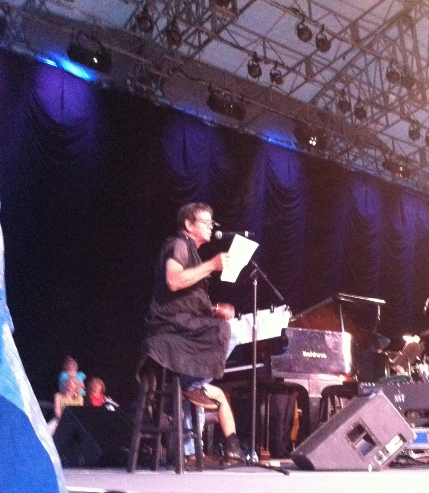 Creator and Co-Producer, Consultant for SHELebration! in Central Park. Lou Reed performing at SHELebration! in photo.