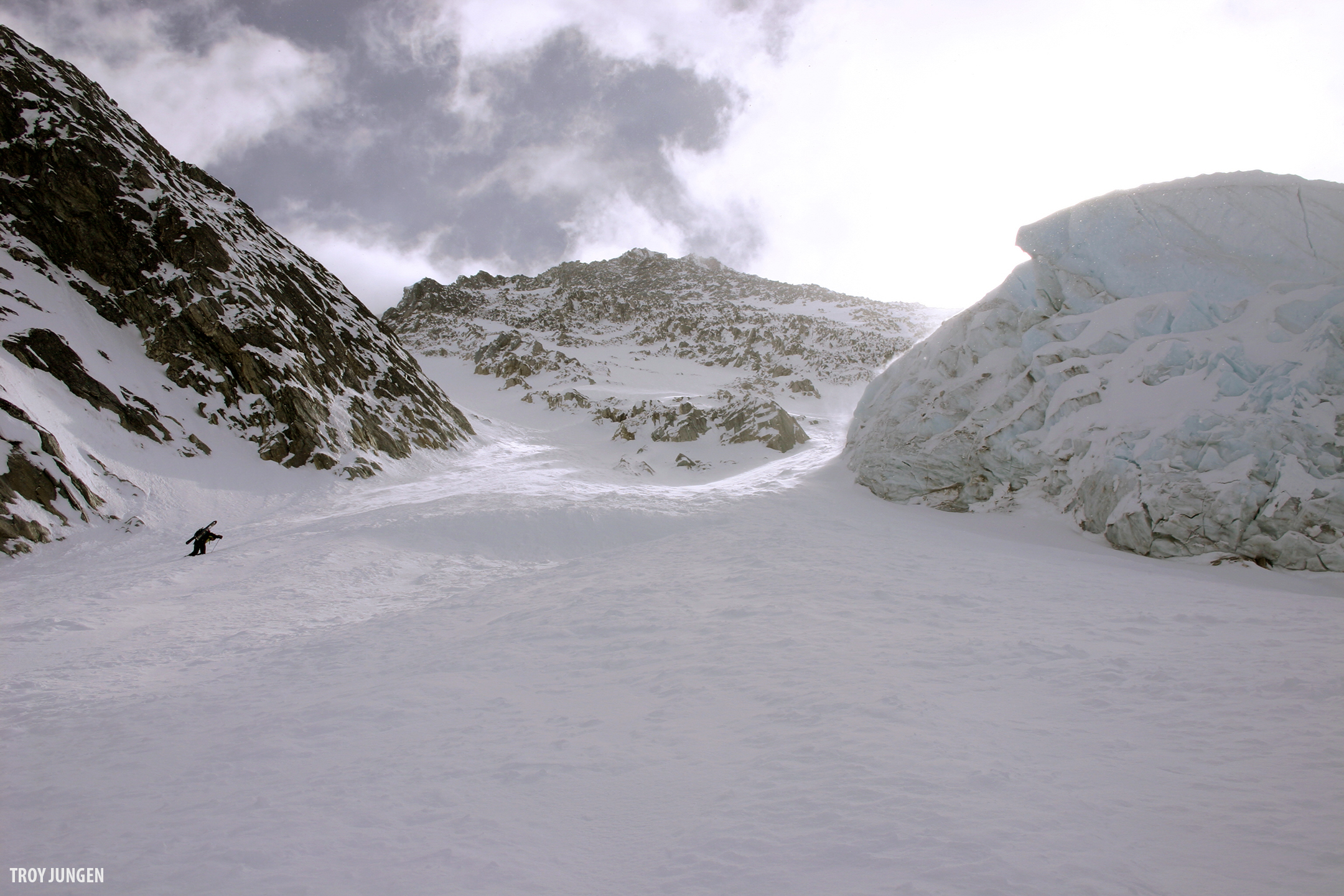 Steep skinning quickly transitioned to bootpacking on the NW Glacier. That's the summit pyramid of Feuz above the hiker.