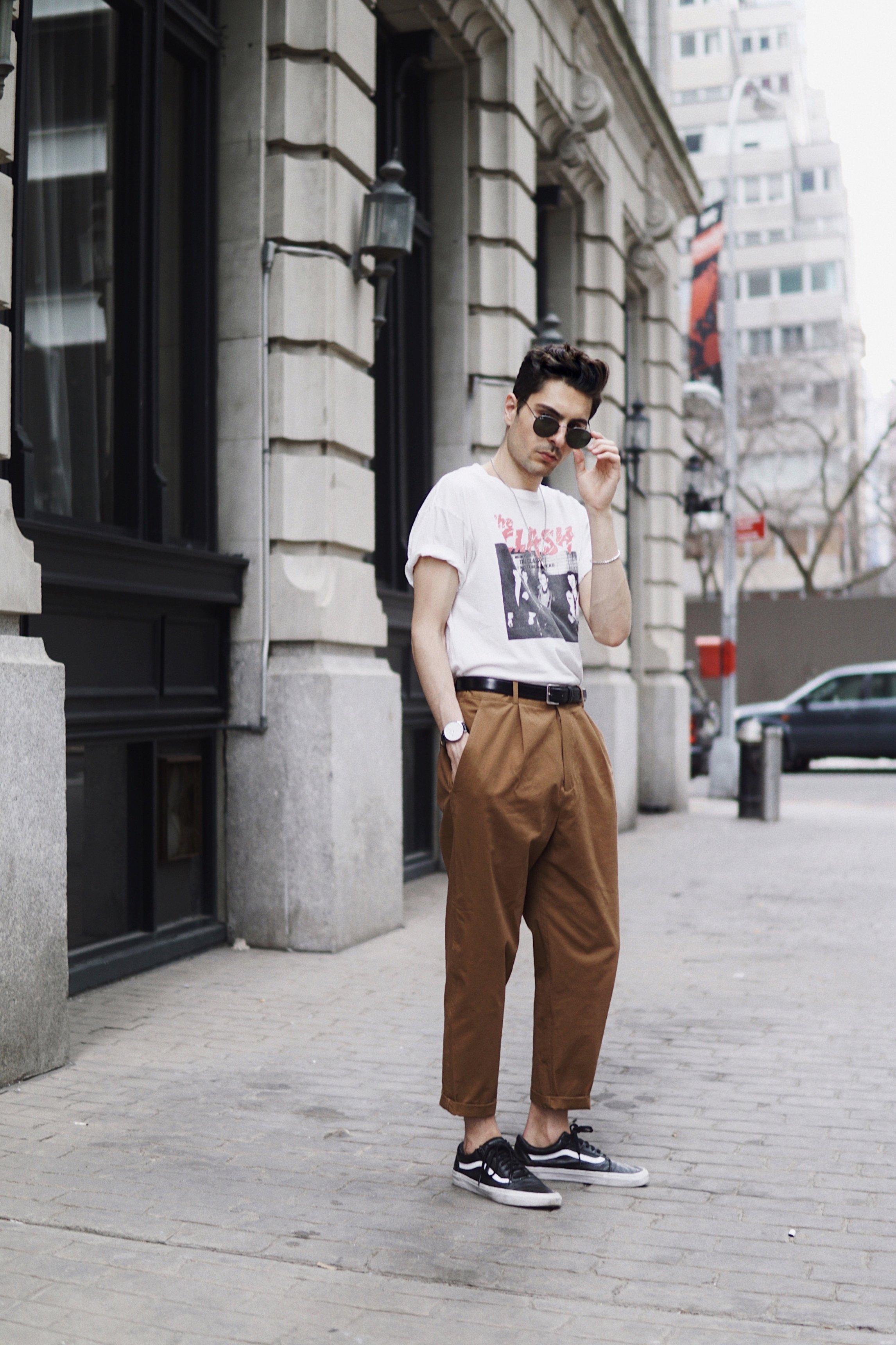PICTURED ABOVE:                                                                                                                  1. COS  TROUSERS . 2. VANS  SNEAKERS   . 3. DANIEL WELLINGTON   WATCH . 4. SIMILAR   BAND TEE .