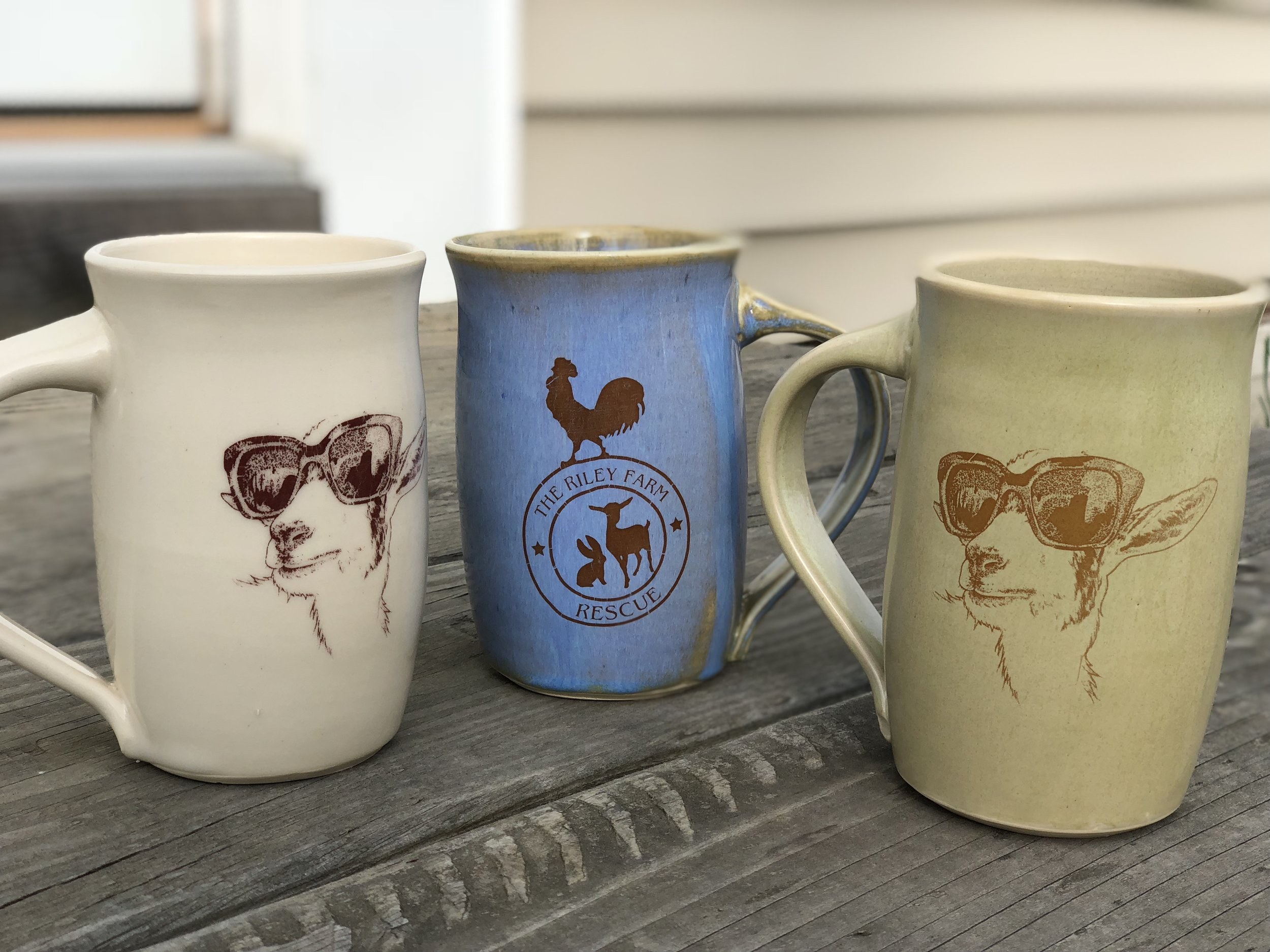 Riley Farm Mugs feature Theodore the hero on one side and the Farm logo on the other. they come in three colors and 35% of the sales go directly to the farm.