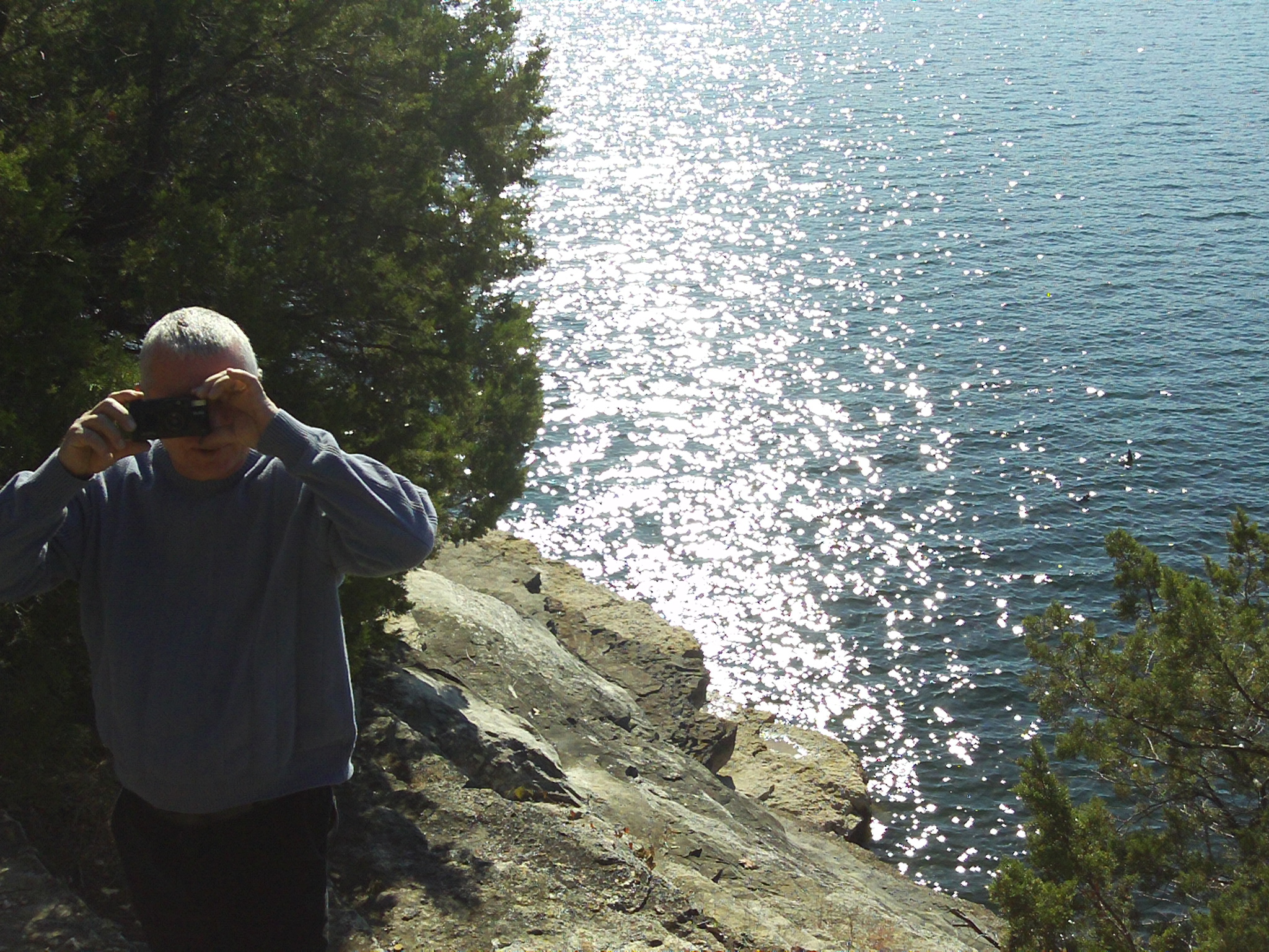 My Dad in 2010, taking a picture of me, taking a picture of him. It was on complete accident, but its a very memorable photo for me.