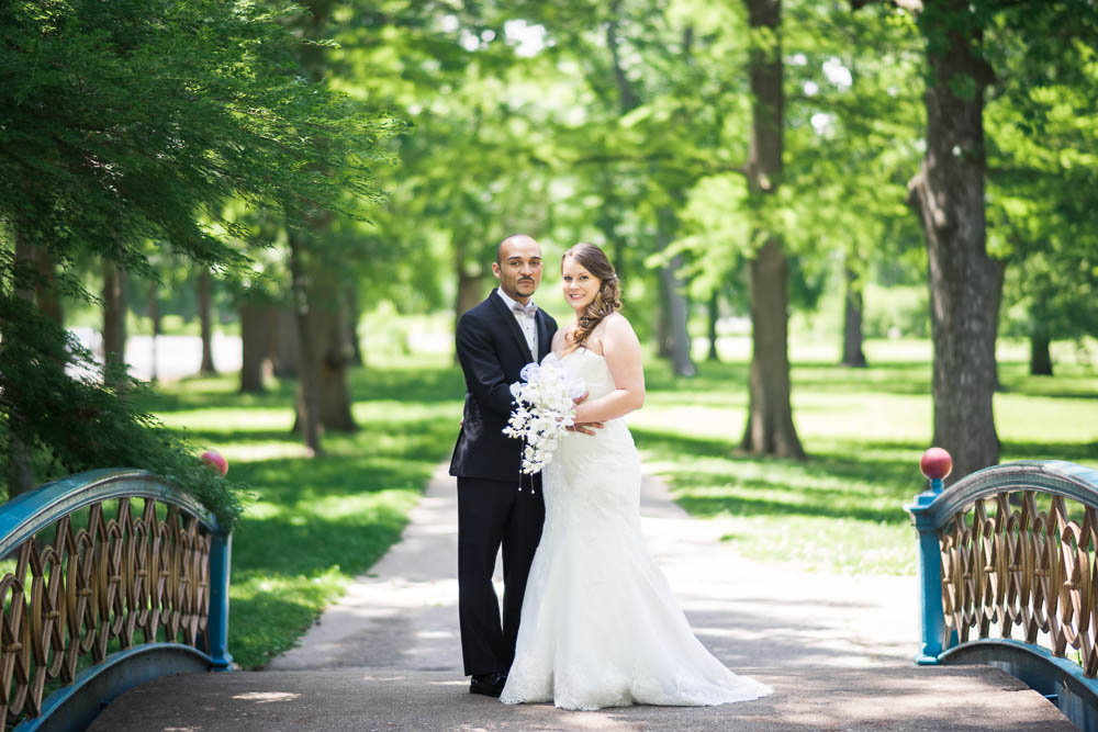 A portrait of a bride and groom in Tower Grove Park.