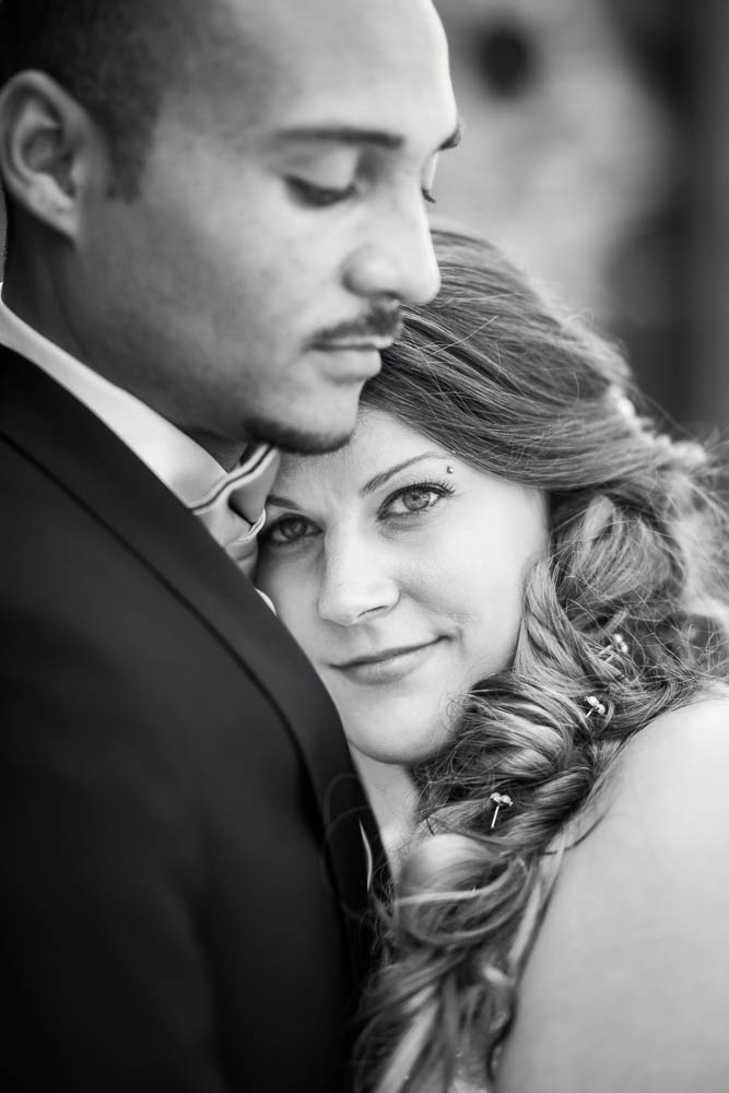 A black and white portrait of a bride and groom in Tower Grove Park in St. Louis.