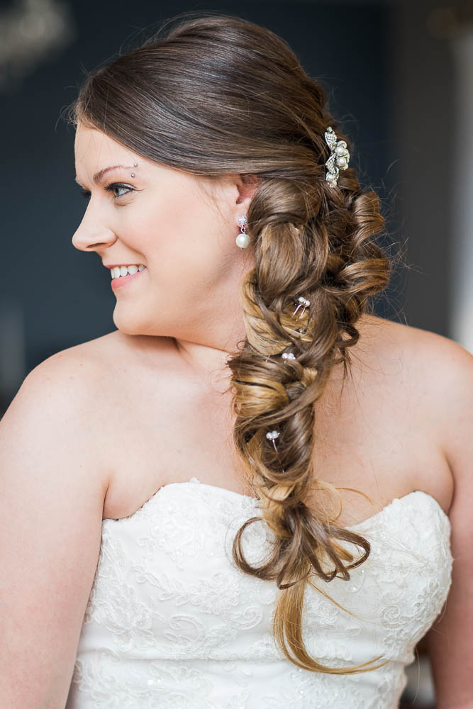 A portrait of a bride while getting ready for her wedding. Photograph taken in St. Louis, Missouri.