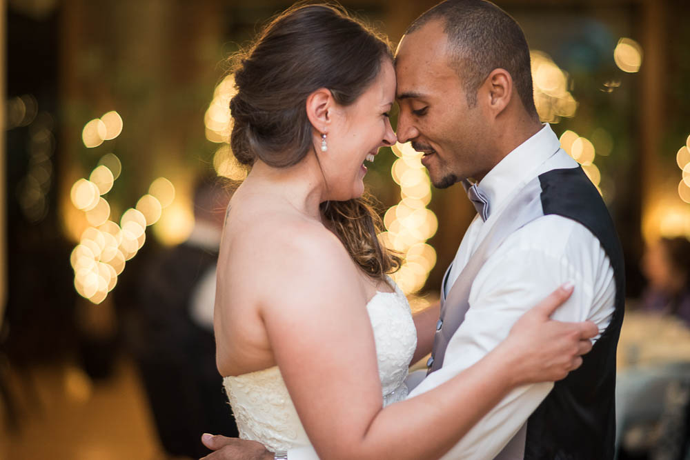 A bride and groom during their first dance at their summer wedding at Windows on Washington in St. Louis, Missouri.