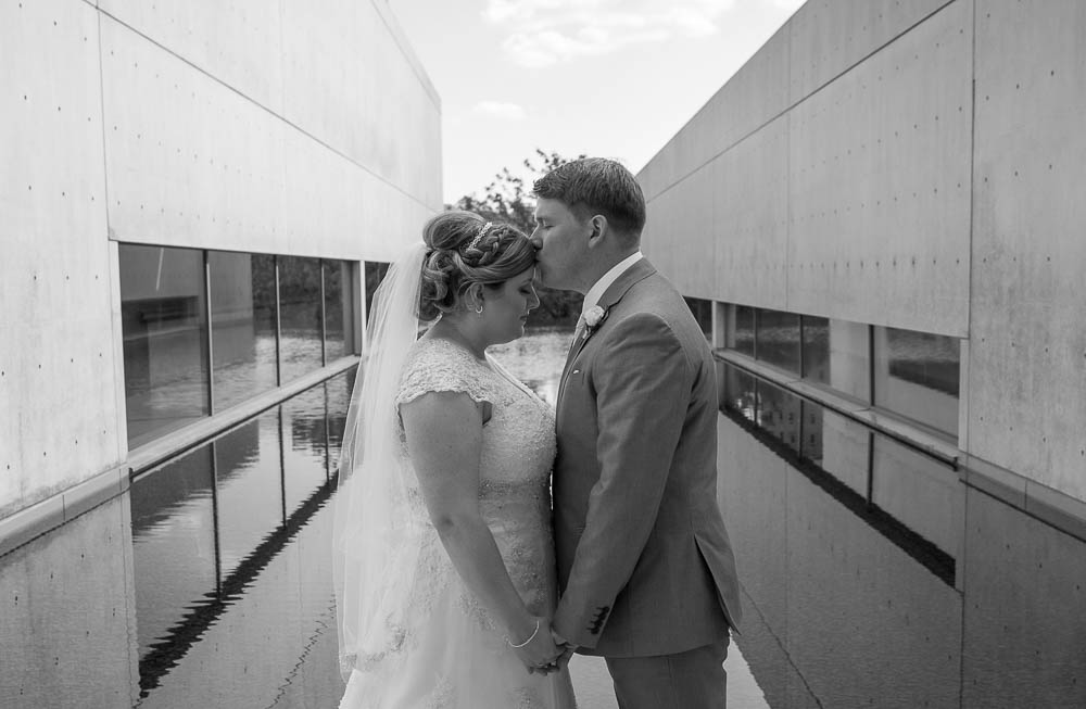 A black and white portrait of a bride and groom after their wedding. Photograph captured at the Contemporary Art Museum in St. Louis, Missouri.