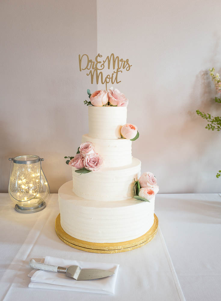 A picture of a bride and grooms cake before the cake cutting ceremony.