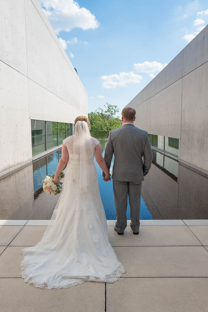 A portrait of a bride and groom posing at the Contemporary Art Museum.