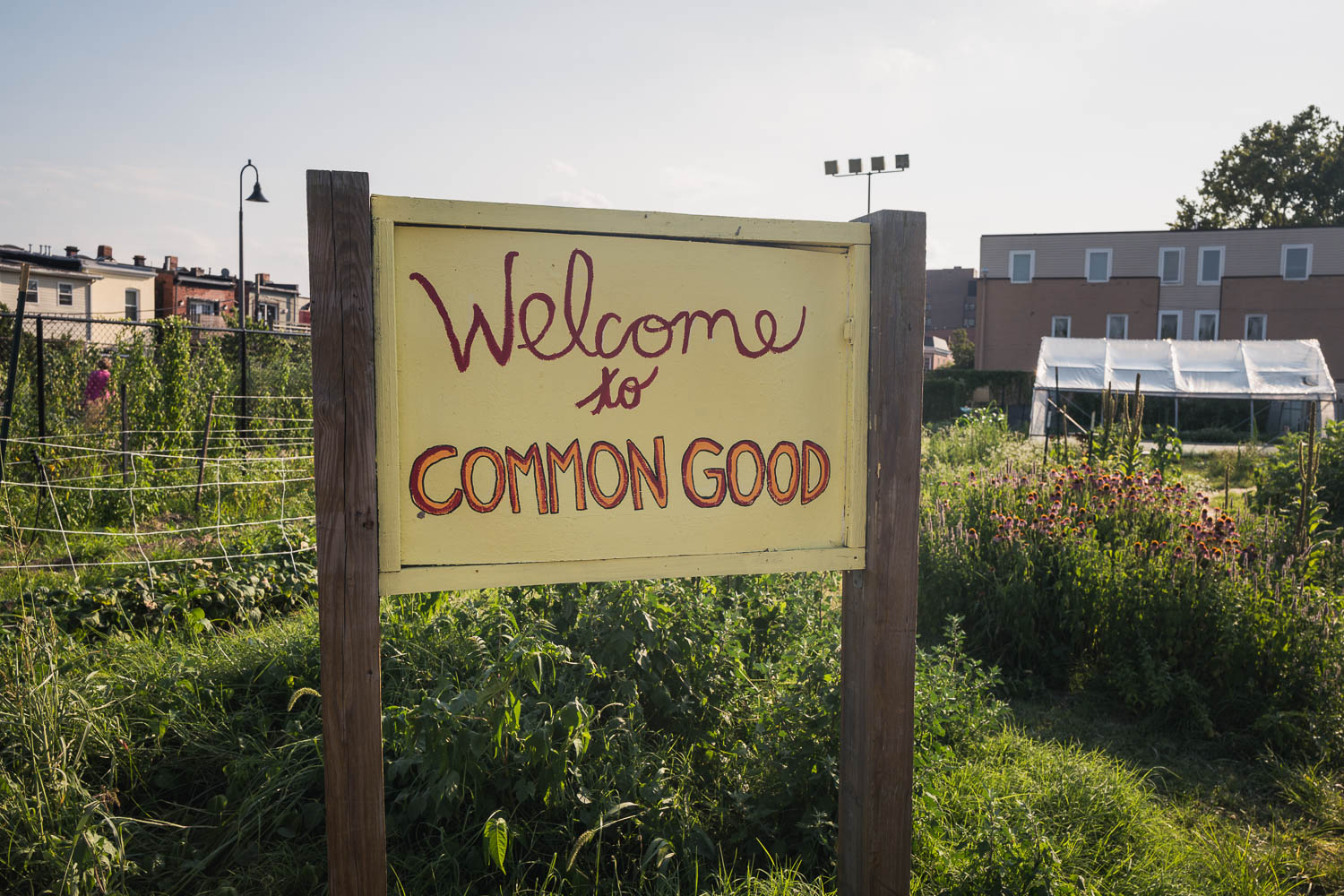 The welcome sign for Common Good City Farm, located in the LeDroit Park neighborhood of Washington D.C.