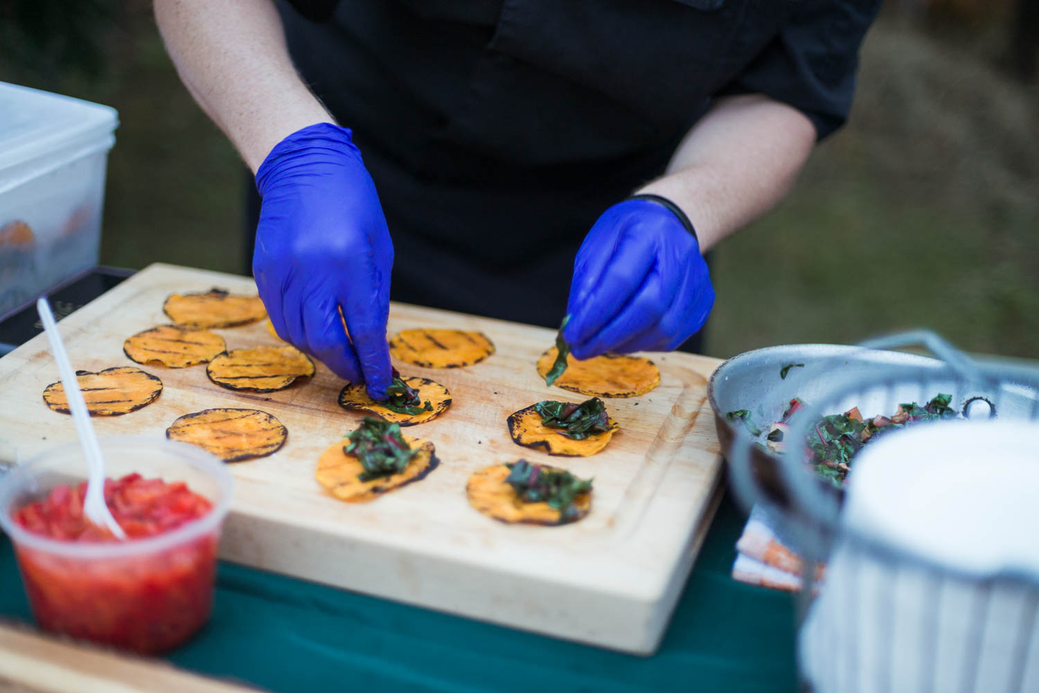 A chef prepares tacos for the annual Common Good City Farm Night on the Farm event.