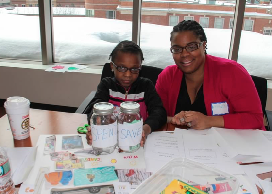 A mom and daughter at our  Make It Count! program, which fosters financial empowerment, familial conversations about money values, and an entrepreneurial spirit.
