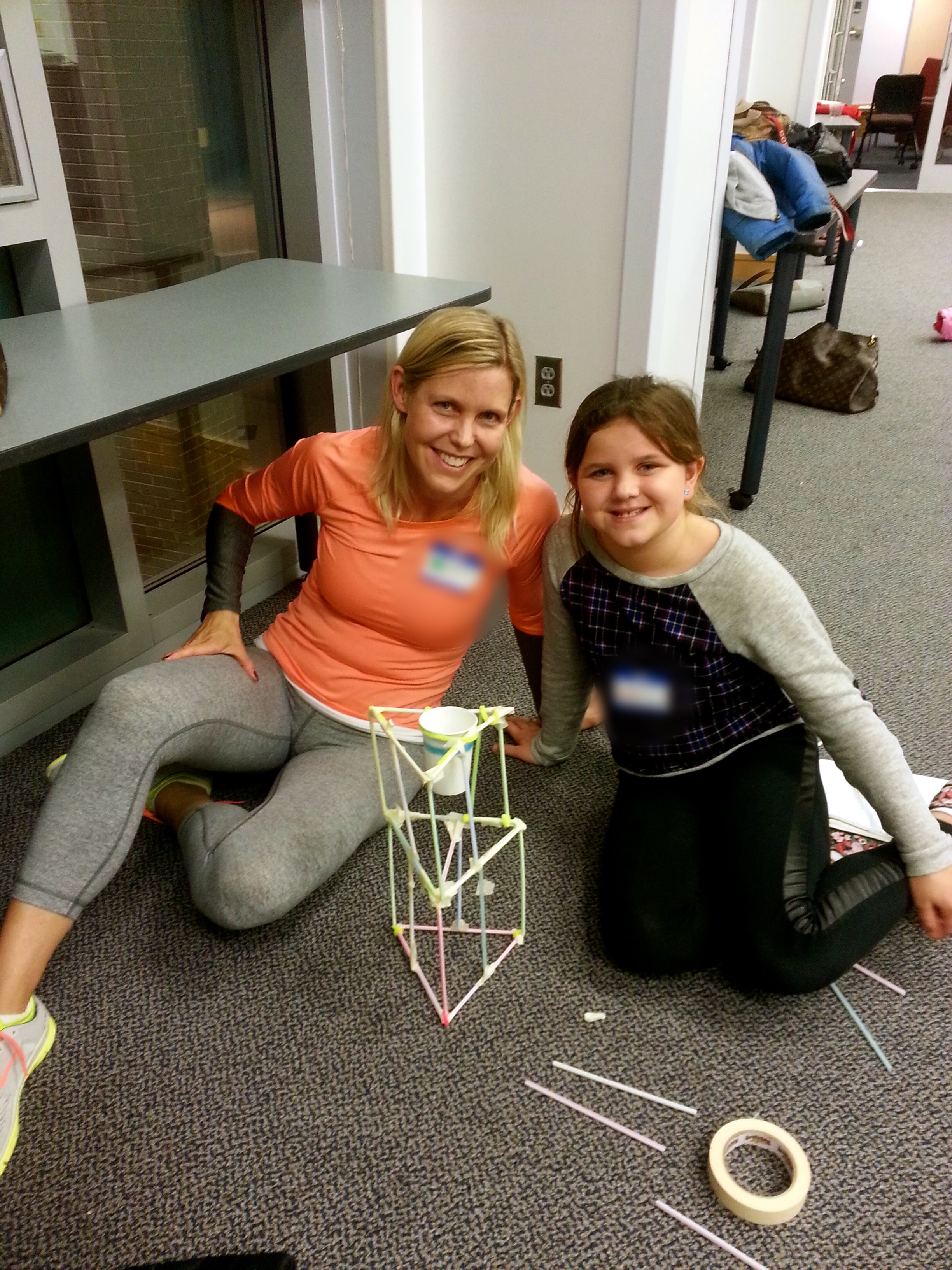 Margot helps out a mom and daughter with their project.jpg