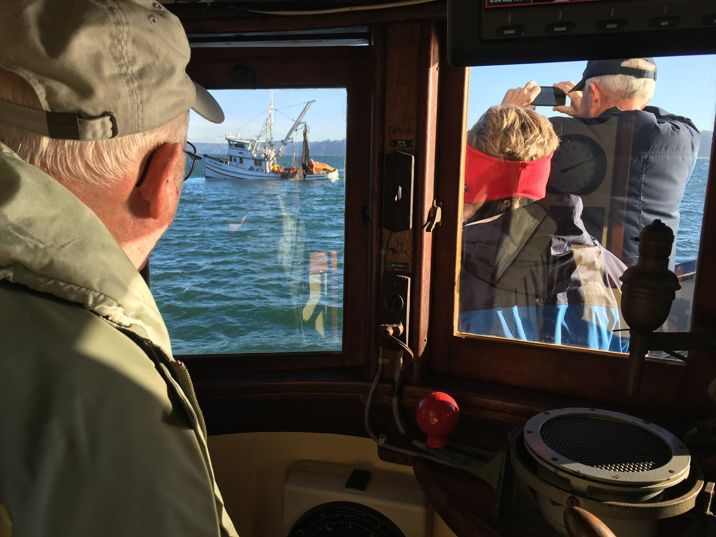 Passengers aboard  Veteran  observe local fisherman plying the waters for salmon during a  Fish Stories  excursion.