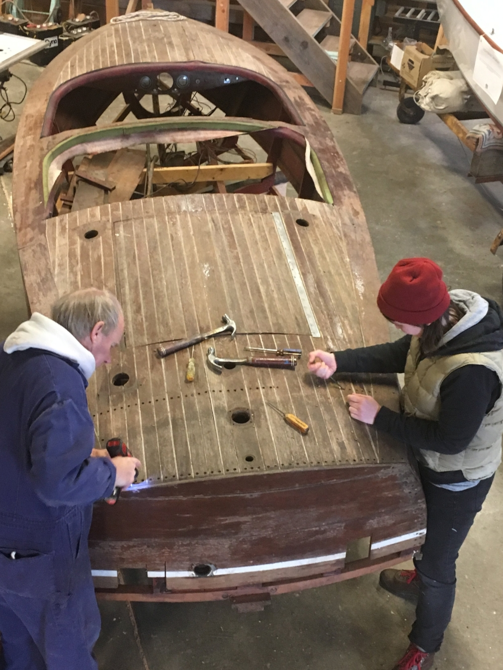 Bruce Bronson and an intern begin to dismantle the boat in preparation for a full restoration.