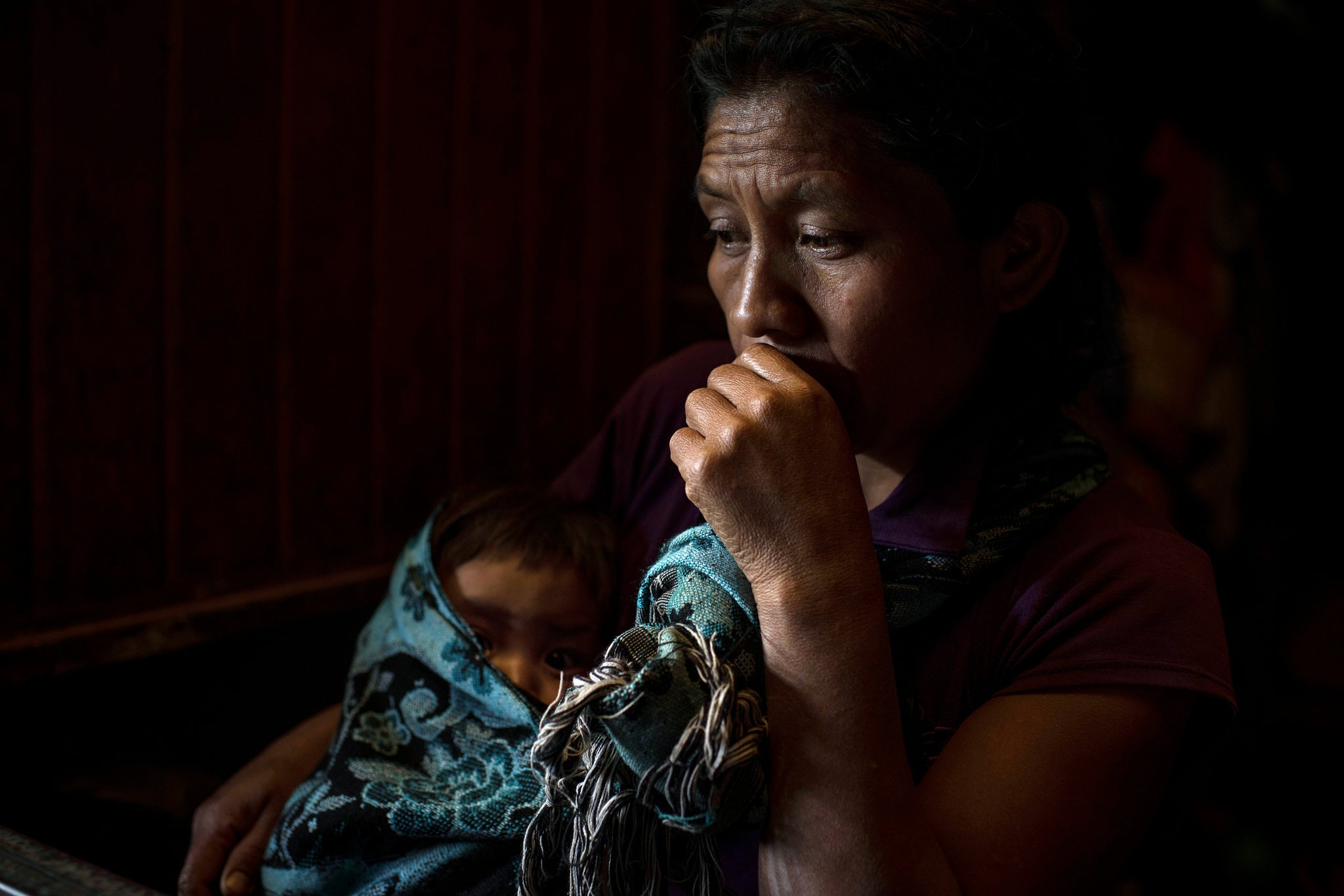 Ana Jorge Jorge holding a nephew. She sees no future for her only surviving son in their Guatemalan village.CreditCreditDaniele Volpe for The New York Times