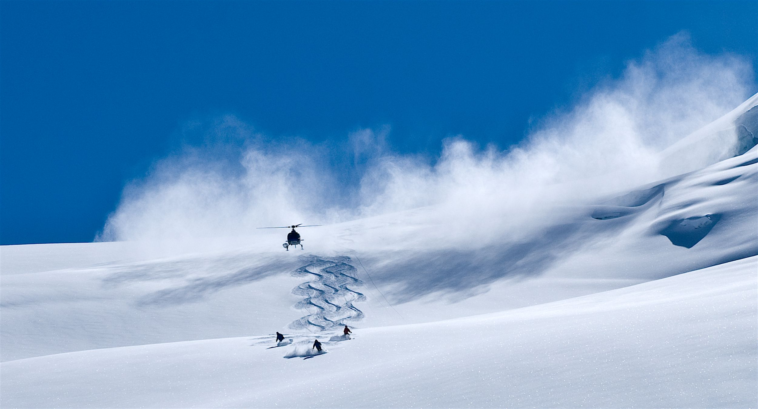 Heli Cloud and Skiers photo Eric Berger and Bella Coola Heli Sports.jpg