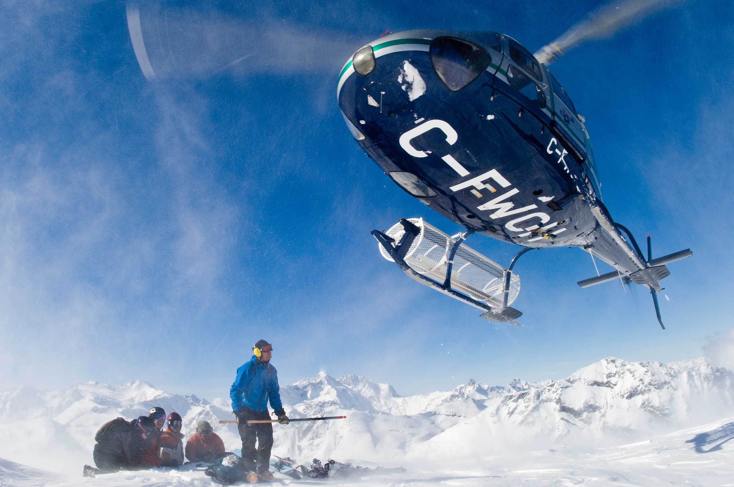 Heli Landing with Group photo Eric Berger and Bella Coola Heli Sports.jpg