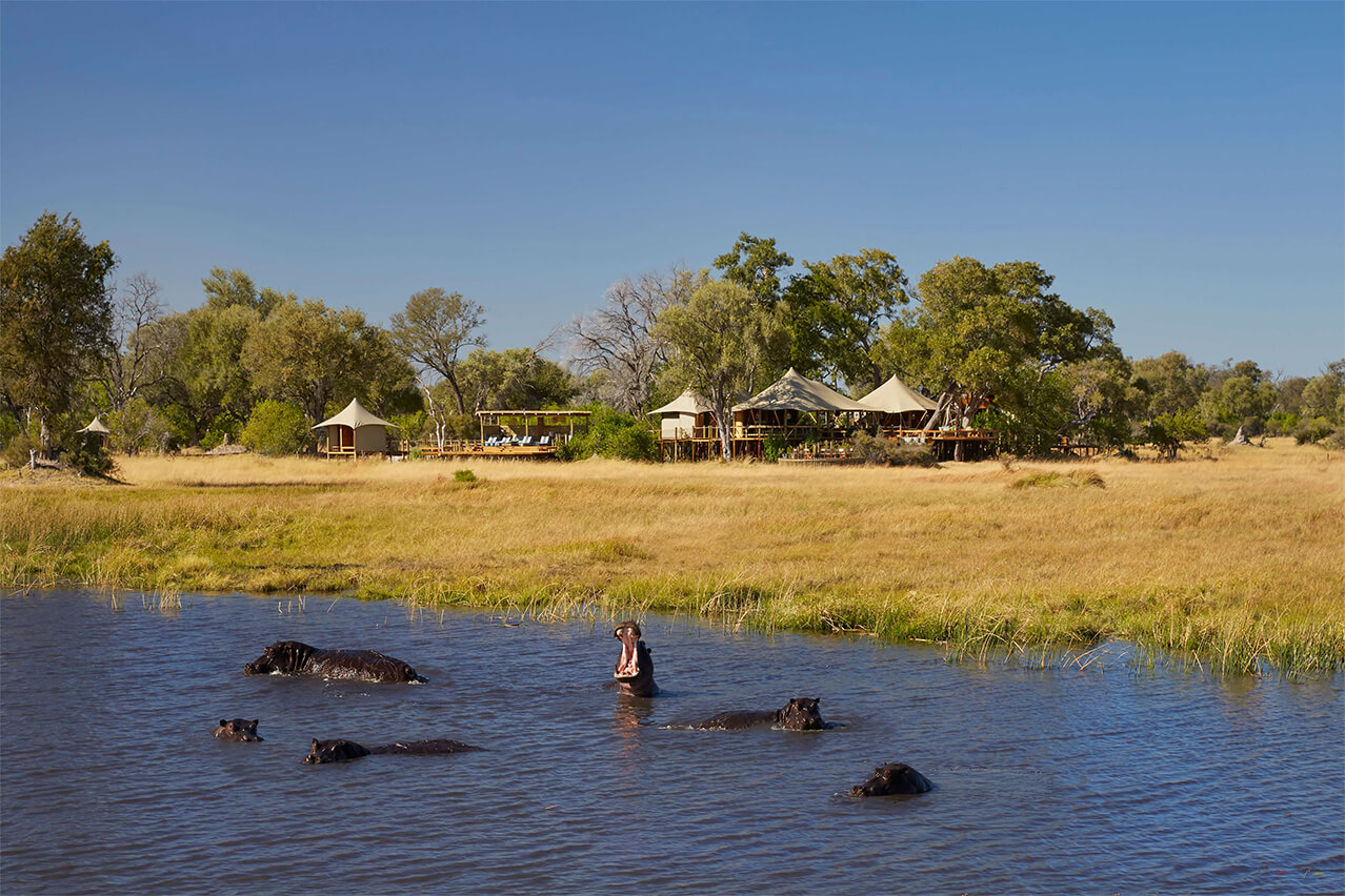 2Tuludi - Camp exteriors and hippos in the lagoon.jpg