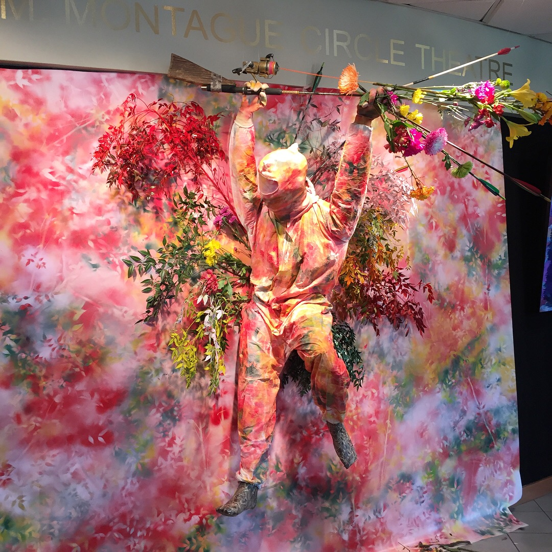 Lovers Leap (station)  2018 vinyl, spray paint, foliage, tape, painter's coveralls & spray sock, found objects