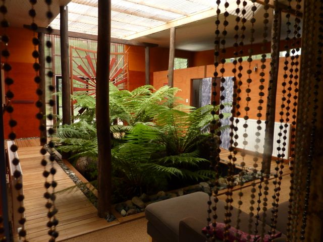 At the sanctuary Ganga Bath House your shower room looks out onto this attractive fern and granite courtyard.