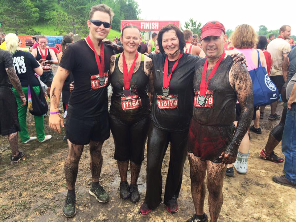 Nate with his wife and in-laws after completing the Warrior Dash