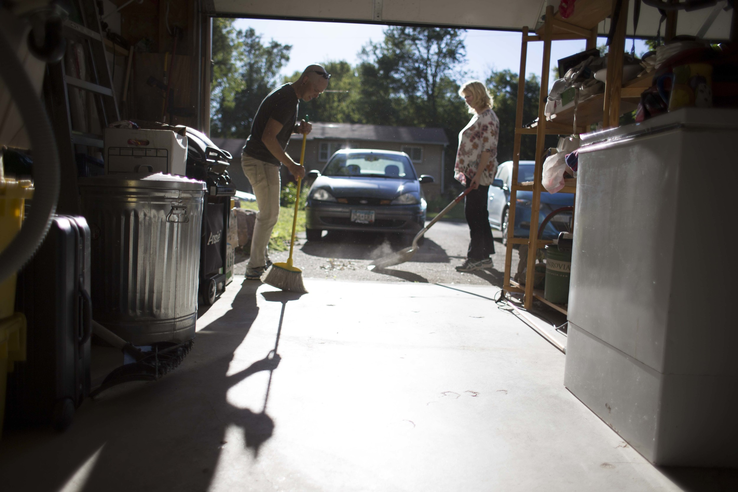 Nate and Jessica clean the garage