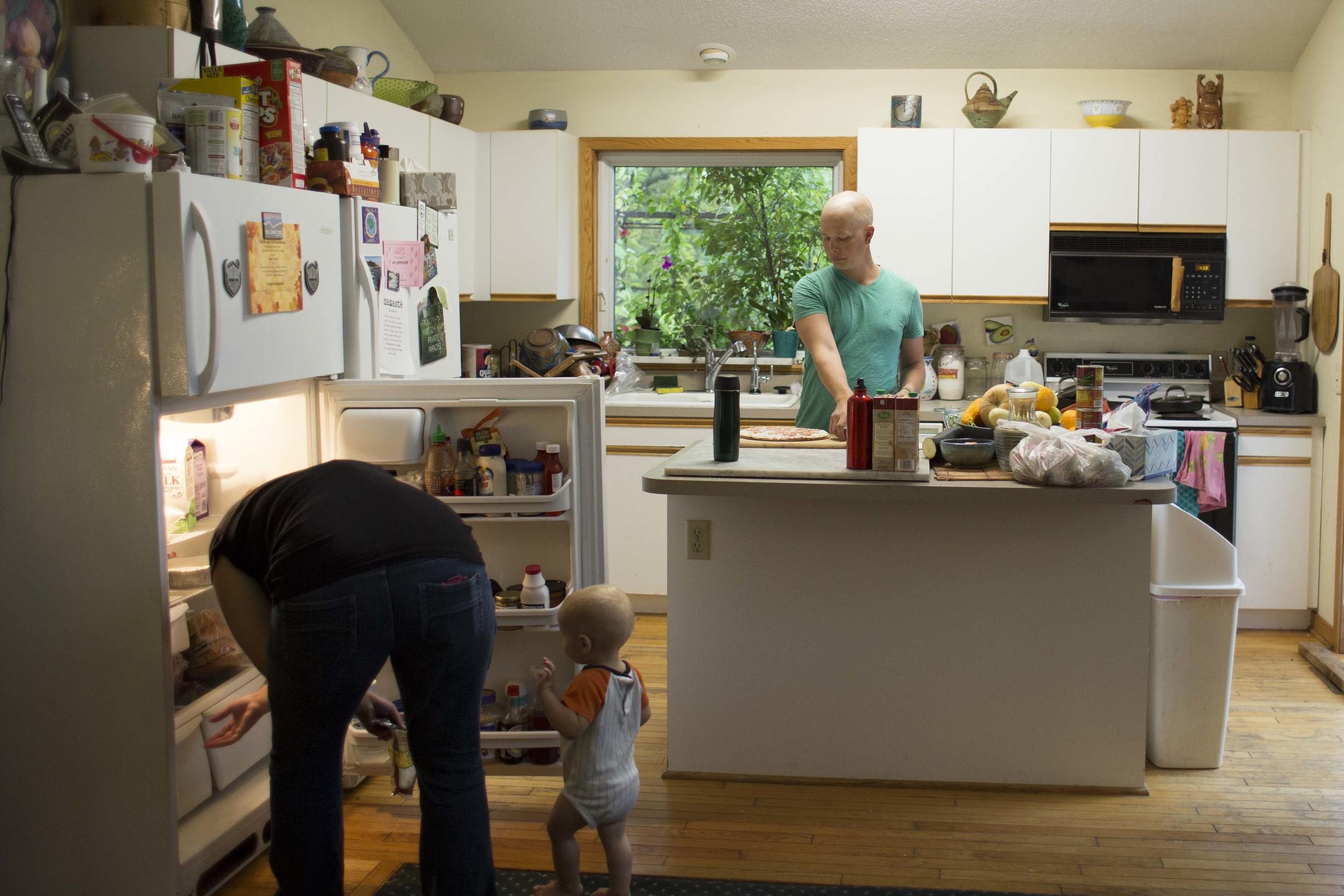 Sarah looks in the fridge with Solomon's help