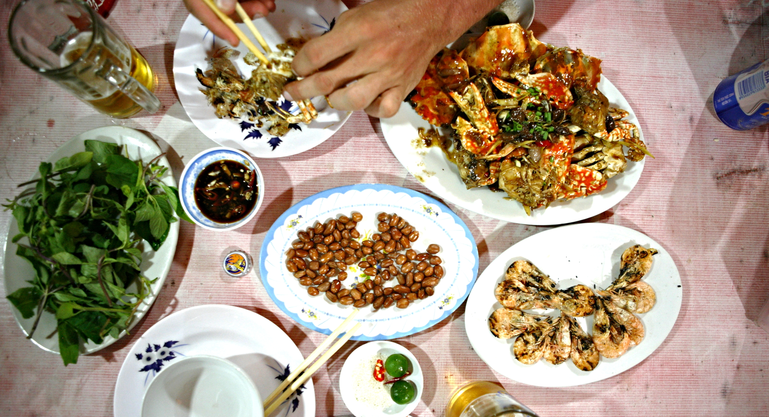 Our Ha Long Bay seafood feast of grilled shrimp, salted skin on peanuts and tamarind crab