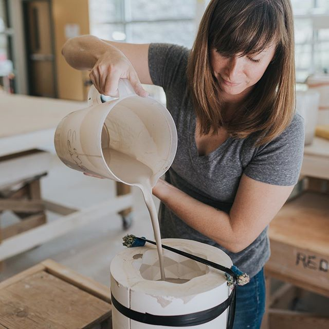 Liz Heller makes ceramics under the moniker @modcrmx. Heller's pieces are handmade in Aspen through a laborious process of design, three-dimensional printing, mold making, slip casting, bisqueing, wet sanding, glazing, and wet sanding again. In this image, Liz is pouring slip into one of her molds. The slip rapidly dries, and the mold gets topped off to maintain an even level of slip throughout the process. After a set amount of time, the wet slip is poured out, and what remains is a thin layer of clay on the mold. Once that has dried, the mold can be taken apart, revealing the vessel. Any edges get sanded away for a smooth finish. . I loved documenting her process and helping show how much thought, energy, and care goes into making every piece. If you are a maker that wants help showcasing their process, please reach out to me! It's some of my favorite work to do.