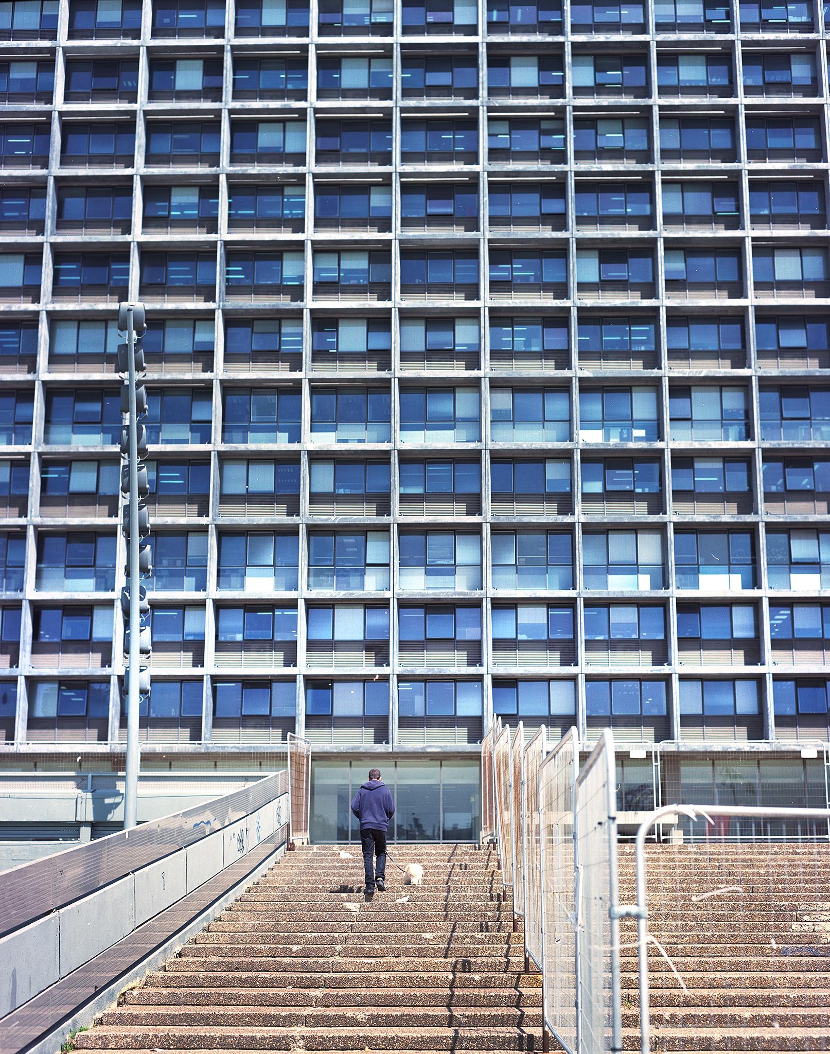 Man ascending stairs kikar rabin copy.jpg