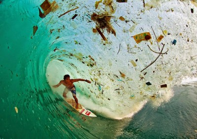 You-Will-Want-To-Recycle-Everything-After-Seeing-These-Photos-Surfing-A-Wave-Full-Of-Trash-Java-Indonesia-–-The-World's-Most-Populated-Island-400x283.jpg