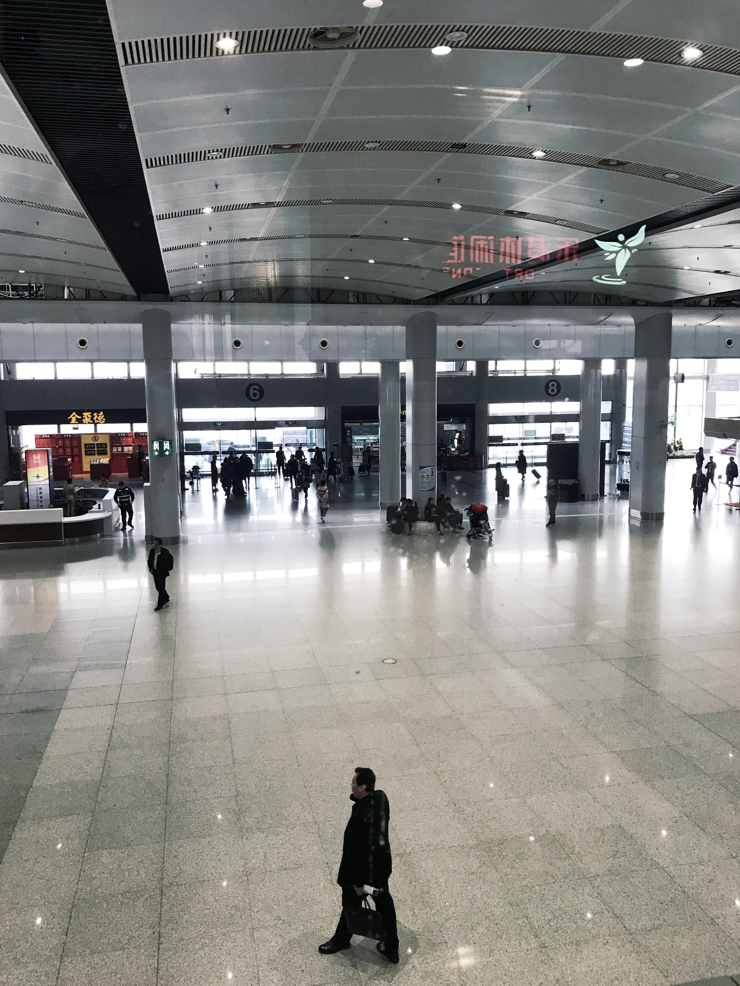 BEIJING AIRPORT - CURRENTLY SITTING AT A PLACE (FROM ABOVE) DRINKING OVERPRICED PU-ER TEA SNEAKING ON PASSERBY WRITING THIS POST WITH FLAT HAIR TIRED EYES TRYING TO LOOK LIKE I HAVE SOMETHING IMPORTANT TO DO. #AIRPORTSTRUGGLES