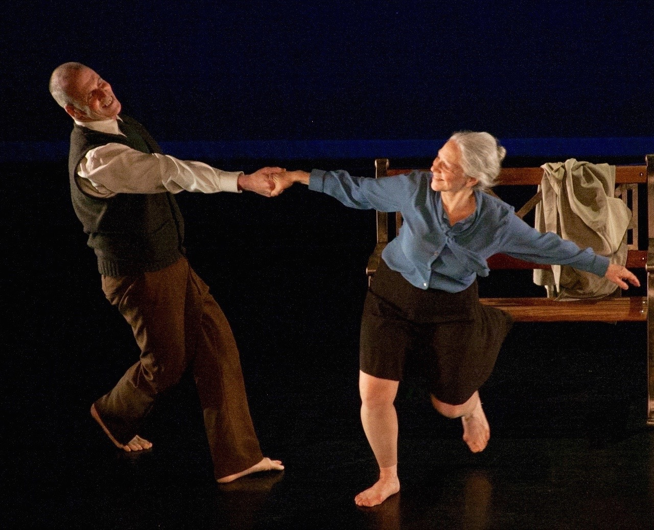 Thomas Sullivan and Sara Schwabacher (Photo Nicole Bennett).  (Smiling male and female dancer hold hands and reach way from each other as woman swirls around.)
