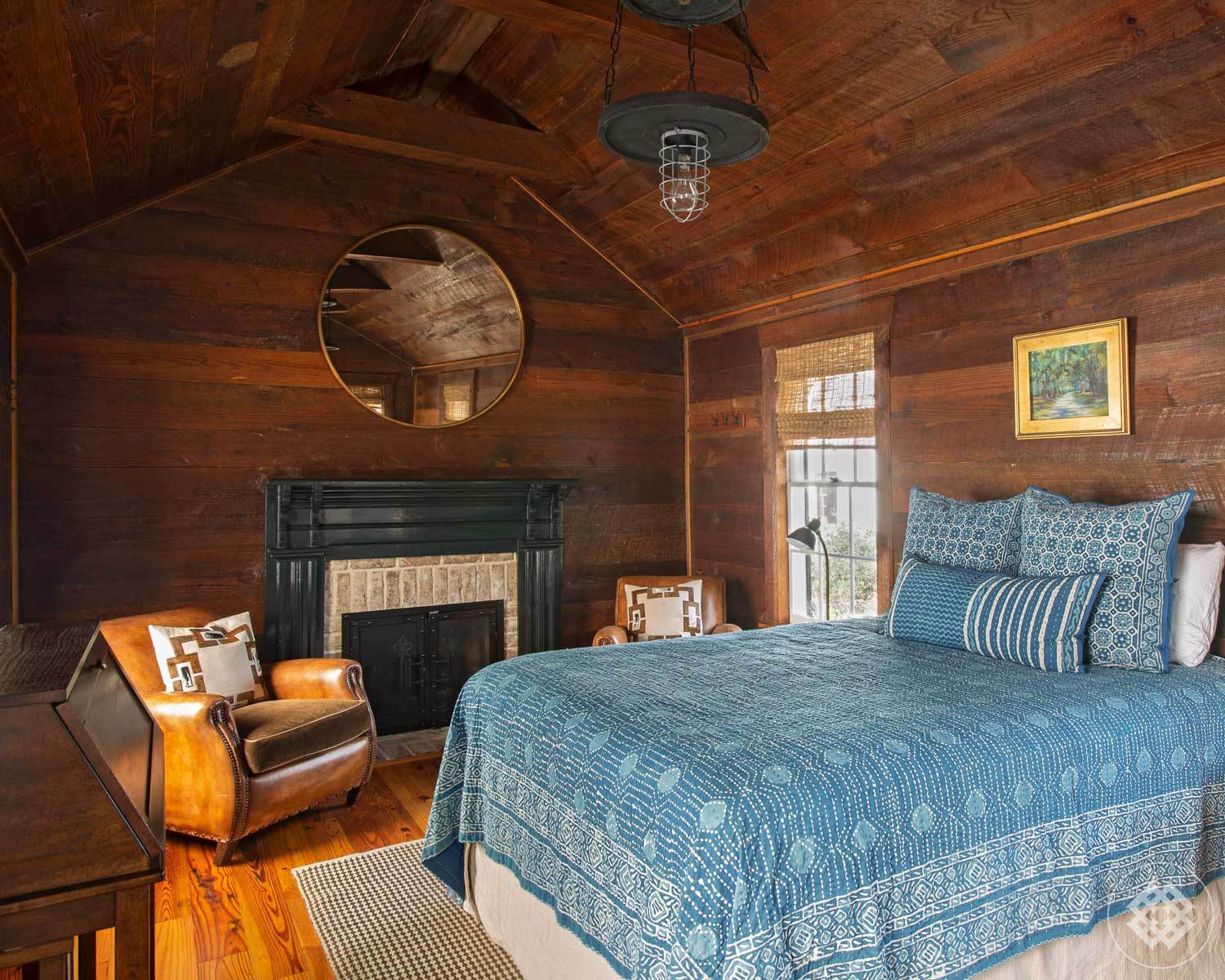 mfh-guest-bedroom-cypress-siding-brick-hearth-fireplace.jpg