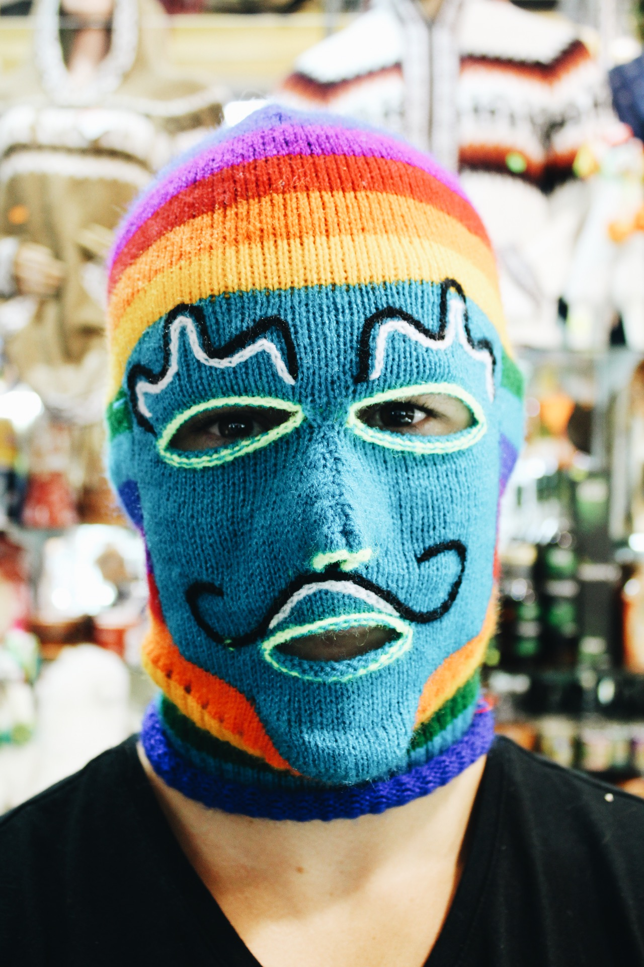 {wade is sporting one of the many brightly colored textiles in the markets - now his new ski mask!}