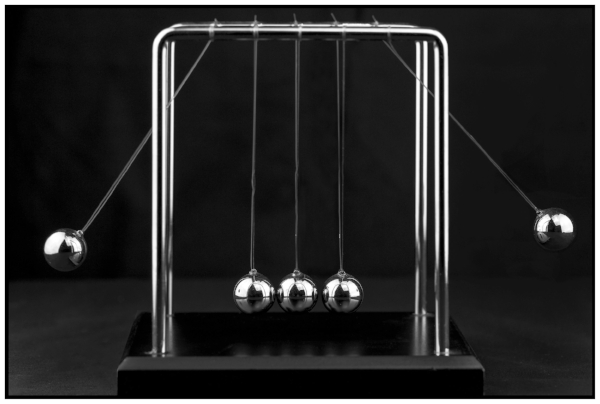 "From intention to action. "" Newton's Cradle "" by Sheila Sund licenced by  CY BY 2.0 ."