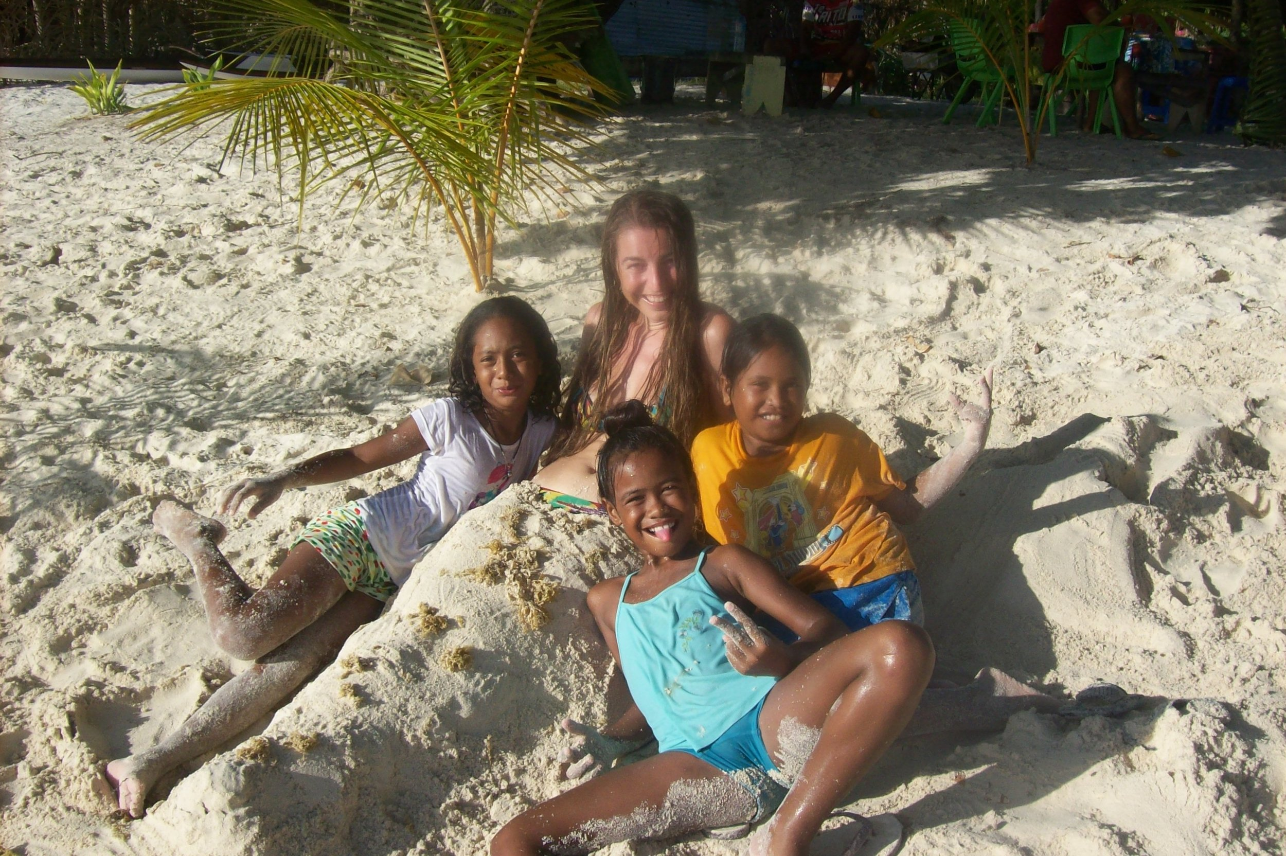 Virginie from SV Photograph with little vahines in Maupiti