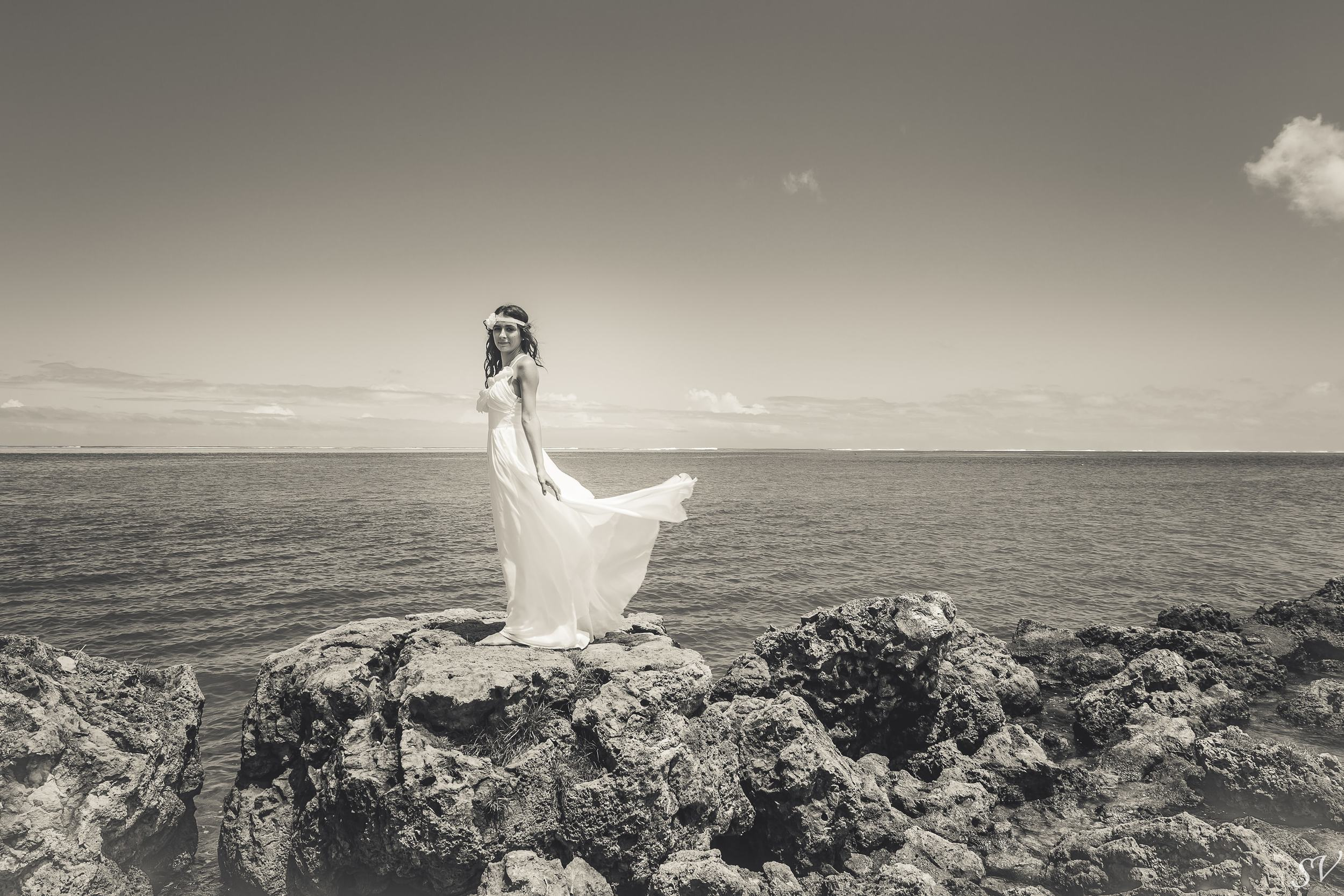 Beautiful bride with her wedding dress floatting
