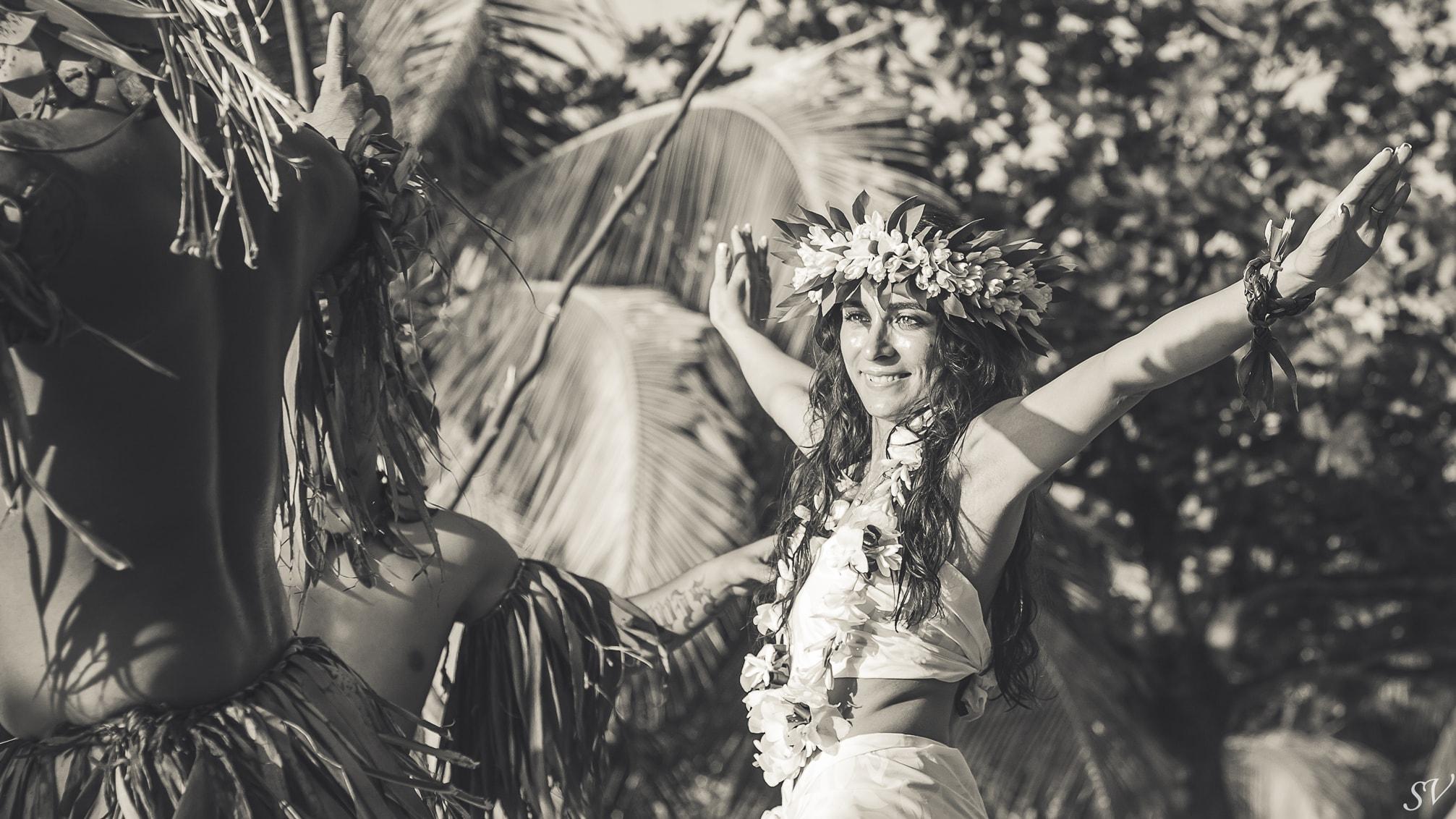 Bride dancing during her beach elopement