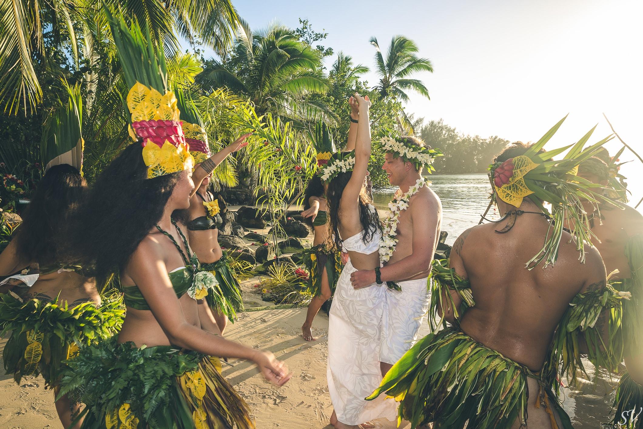 Couple dancing on the beach wedding