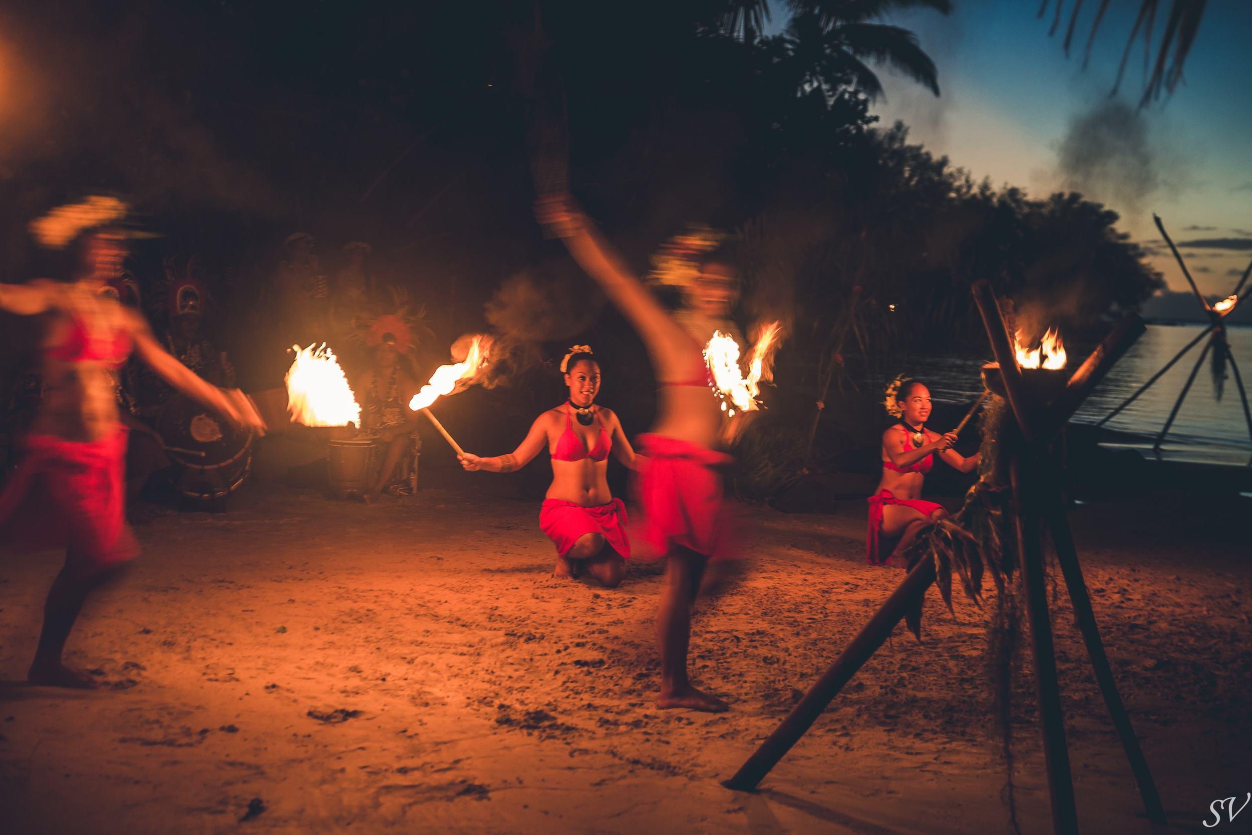 Fire dancer during a wedding on the beach