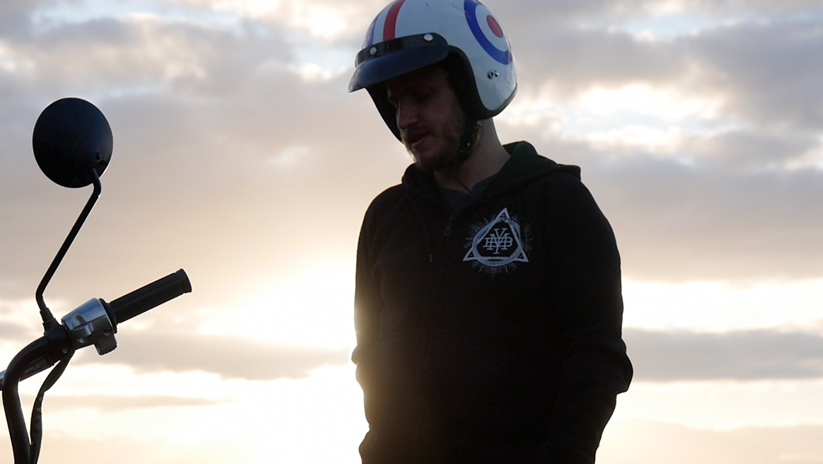 """Motorcycle adventurer Nathan Millward, aka """"The Postman"""" rocking our Triad zipper on a recent MYB shoot… We have a film in the works that documents some of his incredible trips, including his epic ride from Syndey to London on a 105cc postman's scooter and his outlook on adventures and life on the road… More details soon. Zipper hoods are  up in our store for 30 notes!"""