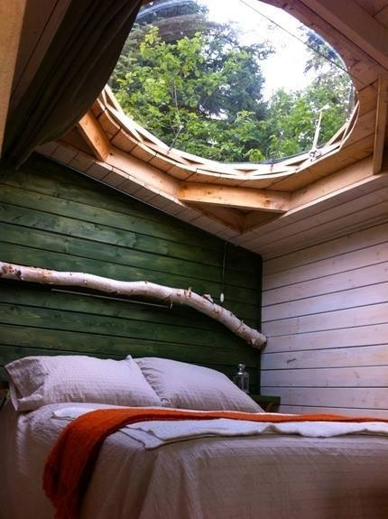 This maybe the first and last time we post a picture of a bed on Make Your Bones, but we'll always make an exception for awesome moon windows..