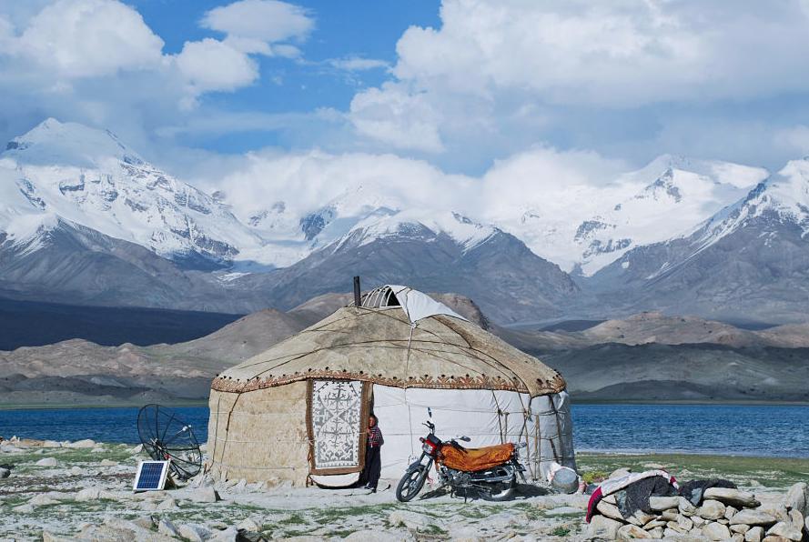 Moto & a yurt somewhere in China.