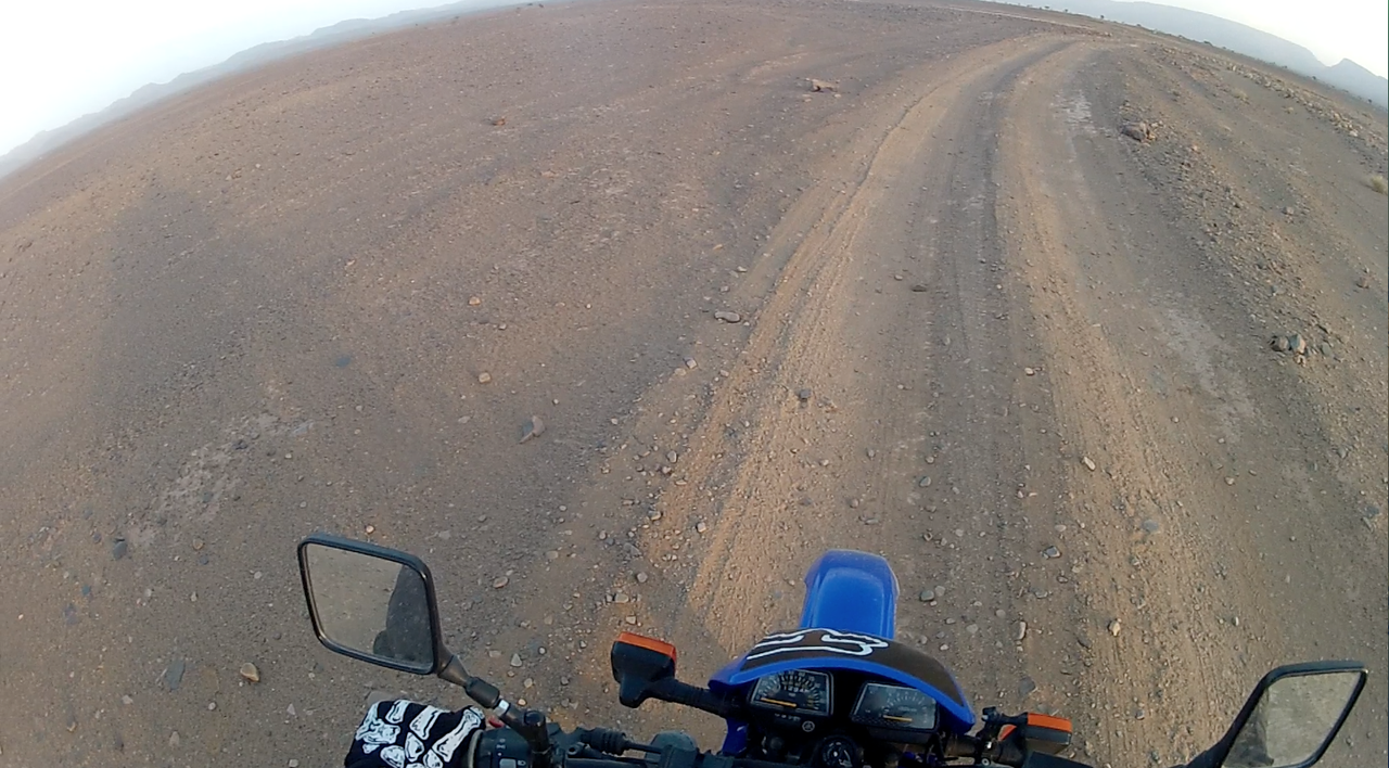 Clocking miles on one of Morocco's awesomely shit 'roads'.
