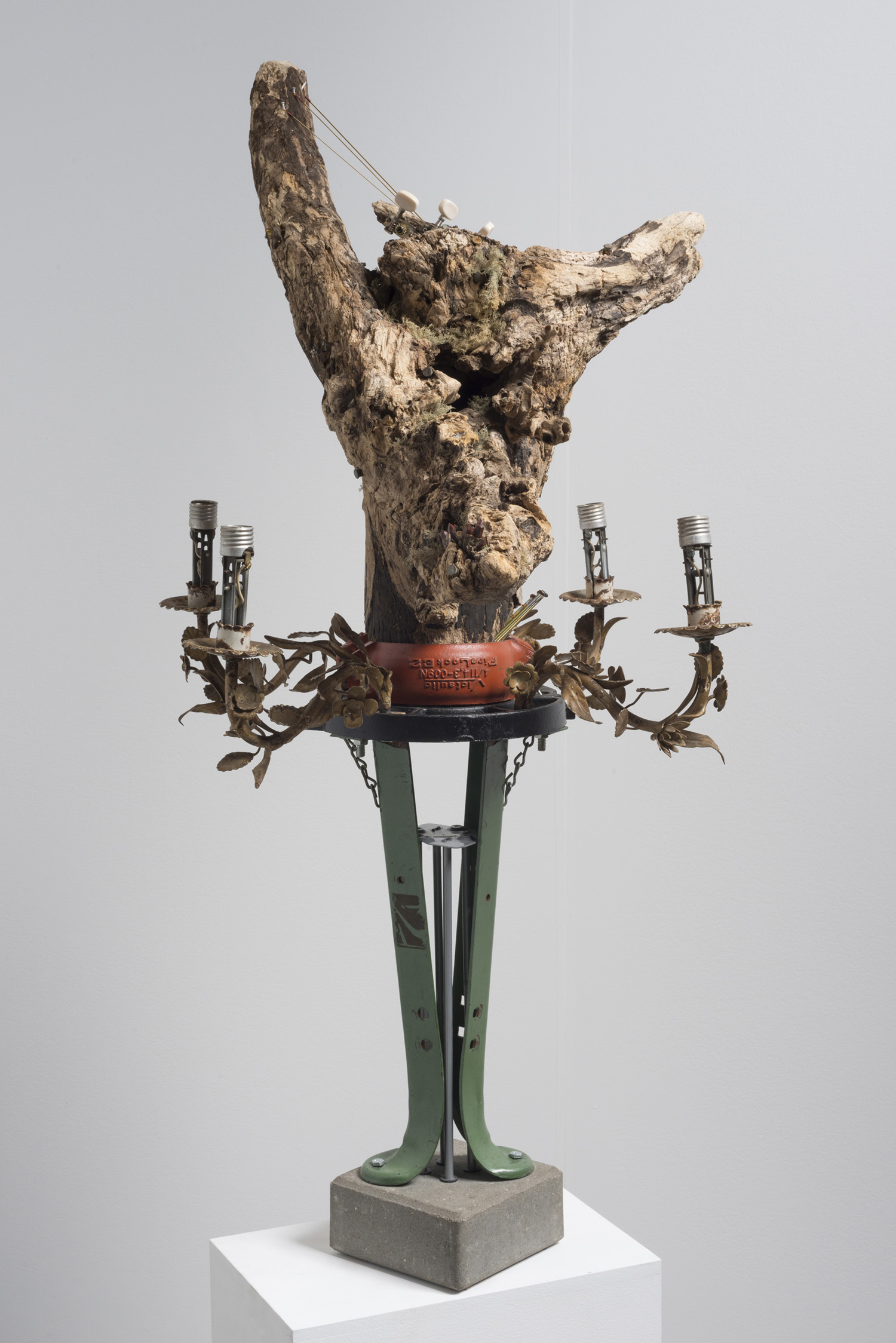 Lorna Williams-spoils-2013-chandelier fixtures, table legs, concrete, chain, plumbing hardware, Spanish moss, ukulele, root system, nails, wasp hive, acrylic, bullet casings-45x20x29-2(2).jpg