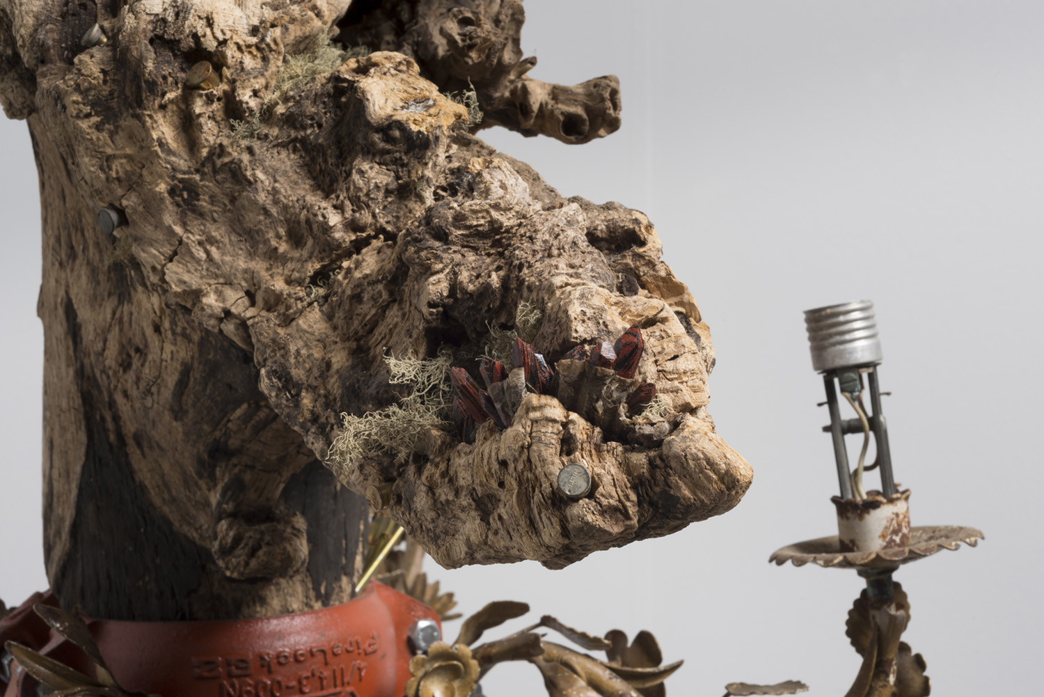 Lorna Williams-spoils-2013-chandelier fixtures, table legs, concrete, chain, plumbing hardware, Spanish moss, ukulele, root system, nails, wasp hive, acrylic, bullet casings-45x20x29-detail-5(2).jpg