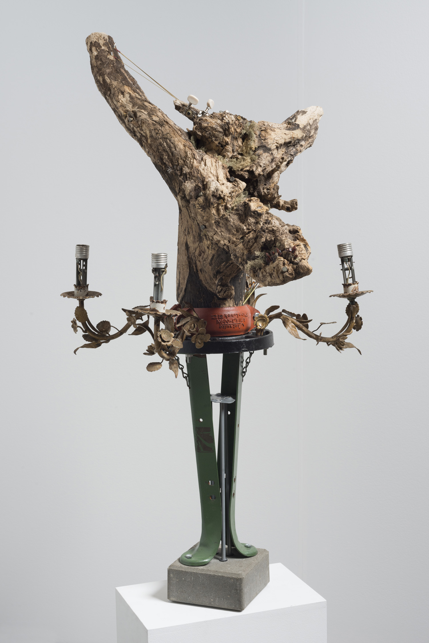 Lorna Williams-spoils-2013-chandelier fixtures, table legs, concrete, chain, plumbing hardware, Spanish moss, ukulele, root system, nails, wasp hive, acrylic, bullet casings-45x20x29(2).jpg