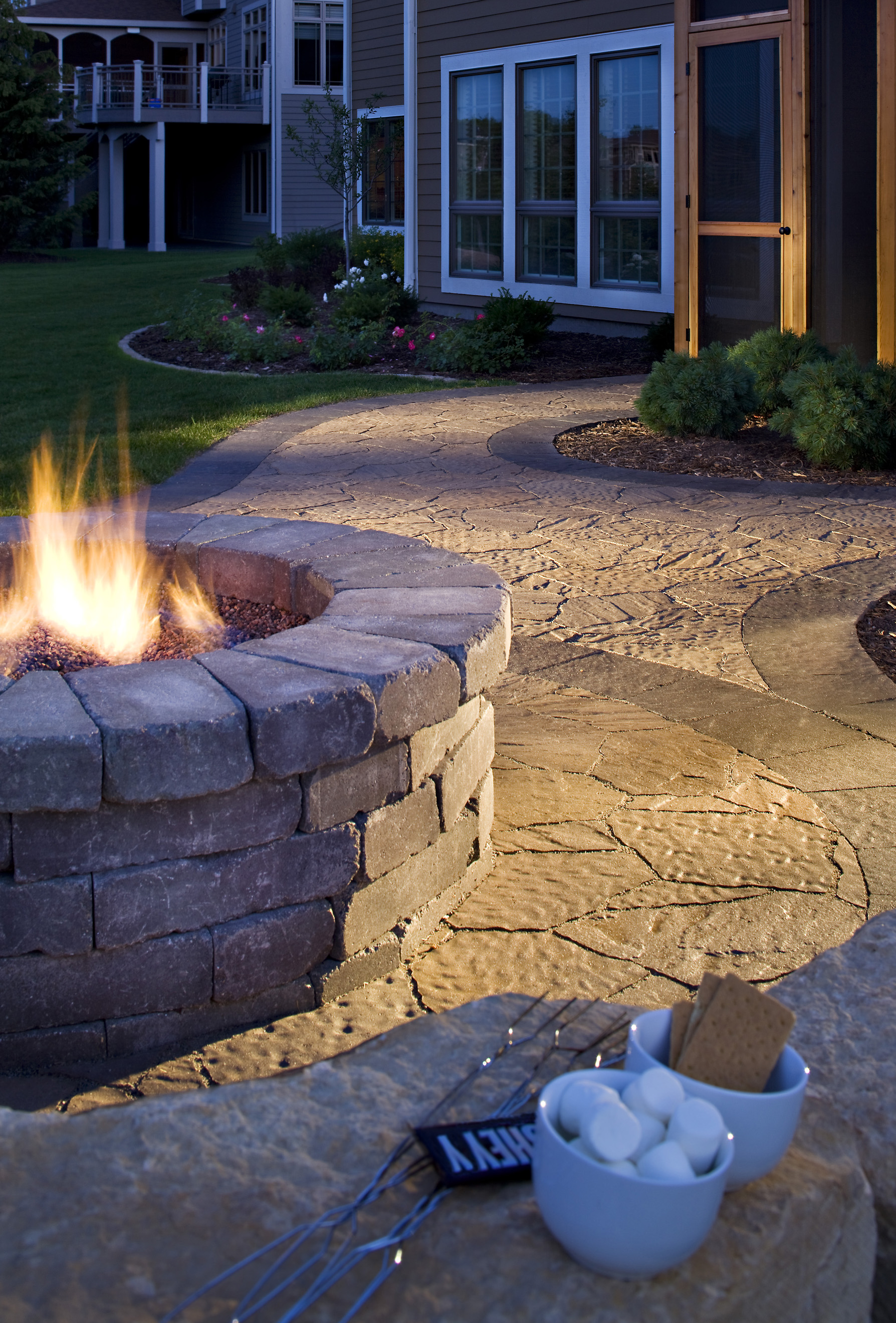fire pit sitting wall paver patio smores relax cozy